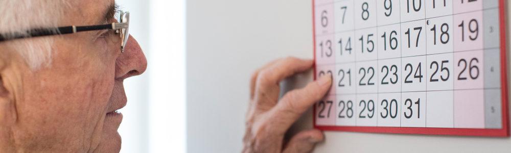 man checking calendar